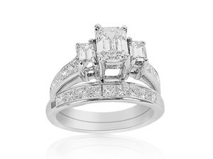 From The Alson Signature Collection, A 14K WG Bridal Set, Features A .90 Ct Center Emerald Cut Diamond, Accented With 2 Baguette & 19 Princess Cut Diamonds, VS2, I, With A Matching Wedding Bands Having 9 Princess Cut Diamonds, Total Diamond Weight 2.90 Ct