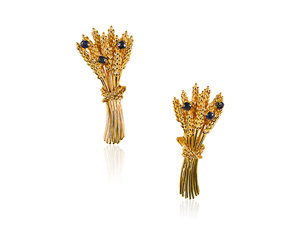 From the Alson Estate Collection, these 18K Yellow Gold Earrings are Each Set with Three Round Blue Sapphires