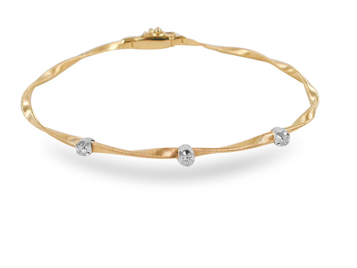 Marco Bicego Marrakech Bracelet, Fashioned in 18K Yellow and White Gold and Featuring 3 Round Diamonds Equaling .15 Carats.