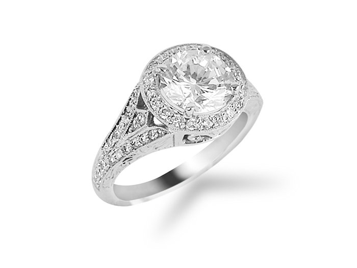 From Penny Preville, this 18K White Gold Grace Frame Style Engagement Ring Features Fofty Eight  Round Diamonds =.38cts Total Weight, with Engraved and Milgrain Detail. Center Stone Sold Separately.
