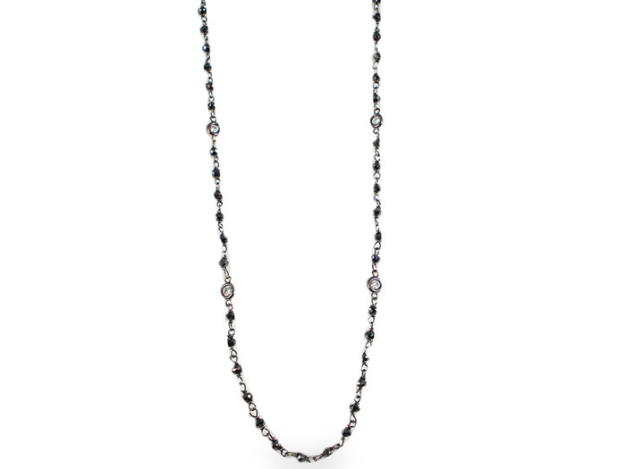 From Penny Preville, this 18K White Gold Sixteen Inch Necklace Features Black Diamond Beads =6.50cts Total Weight with Ten Round White Diamond Eyeglass Settings =.40cts Total Weight