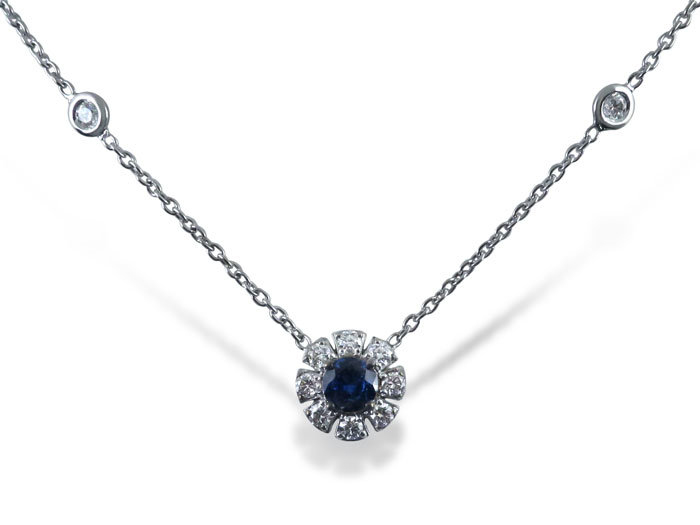 Penny Preville 18K White Gold Necklace, Featuring a 5MM Round Blue Sapphire Weighing .66cts, Accented with Ten Round Diamonds =.42cts Total Weight