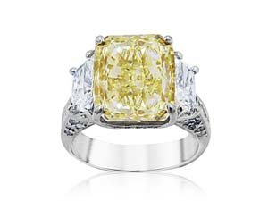 Alson Signature Collection Platinum & 18K Yellow Gold Engagement Ring, Featuring a 5.85ct Radiant Fancy Yellow Diamond, VS1 Clarity, GIA Certified, Accented with 2 Trapezoid Diamonds =1.02ctw, 10 Princess Cut Diamonds =.38ctw, 48 Round Diamonds =.26ctw and 18 Round Fancy Yellow Diamonds =.10ctw
