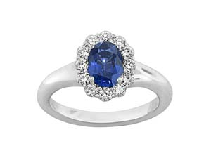 Spark 18K White Gold Halo Ring, Featuring a 1.00ct Oval Blue Sapphire, Accented 12 with Round Diamonds =.42ctw