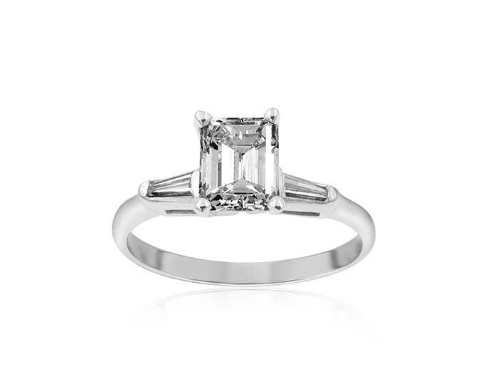 From the Alson Signature Collection, this 14K White Gold Engagement Ring Features an Emerald Cut Center Stone which is .82 Carats, VS2 Clarity, J Color, and Two Tapered Baguette Diamonds =.20cts Total Weight